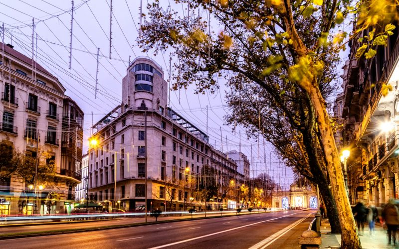 Alcala Street in Madrid with Christmas decoration at sunset